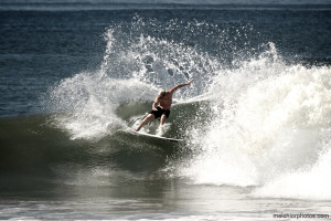 Surfing the waves while staying at Hotel Makanas Costa Rica beach bungalows in MalPais