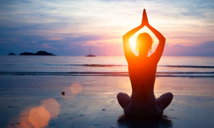 Yoga at the beach at Makanas Hotel