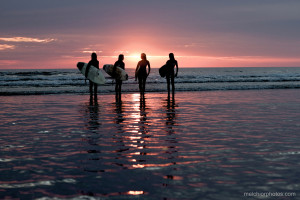 Surfing at sunset while staying at Makanas Hotel in Santa Teresa beach bungalows in MalPais